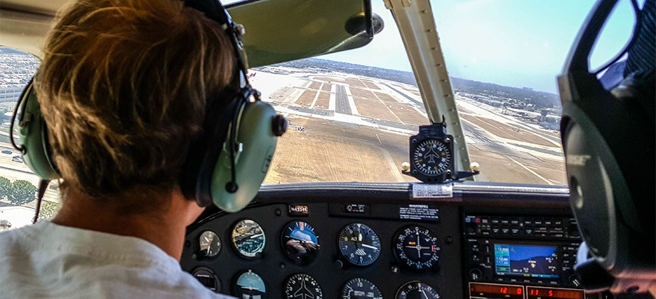 Student piloting a plane offered by the aviation program