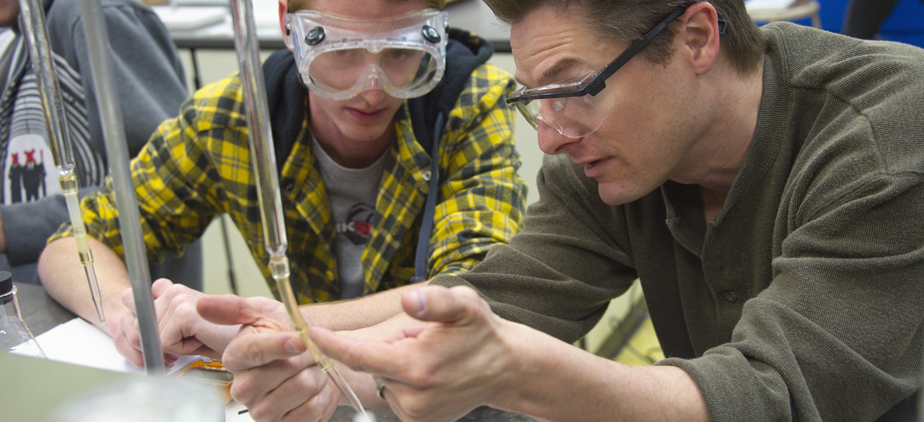Professor helping a student in a chemistry lab