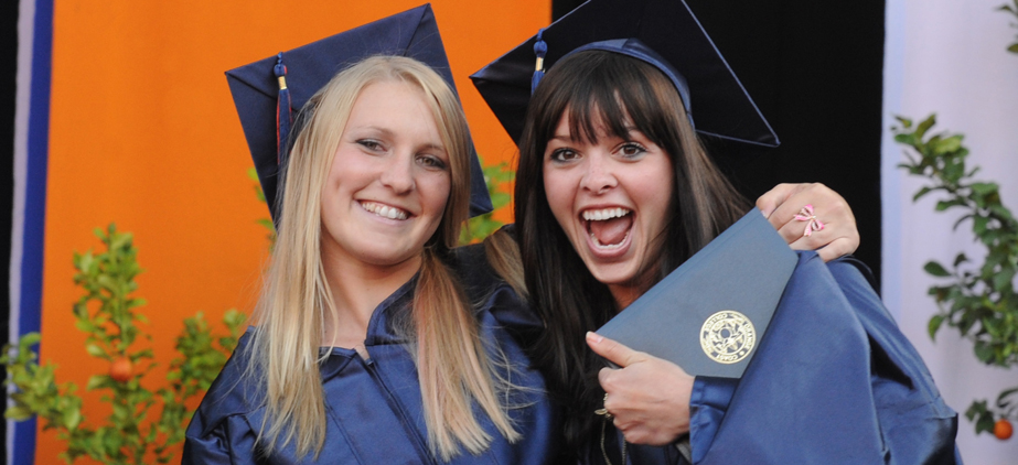 2 graduates at the commencement ceremony