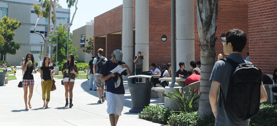 Students walking by the library