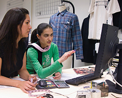 2 students working by a computer