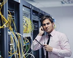 IT network specialist working in a data center