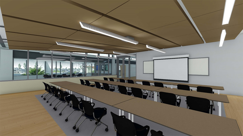 Classroom with 3 rows of seating and projector screen at the front