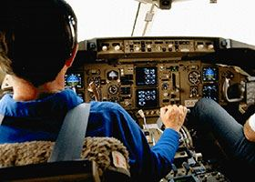 Male pilot in blue shirt flies plane