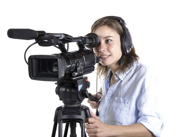 Woman in white shirt operates a camera and mic set