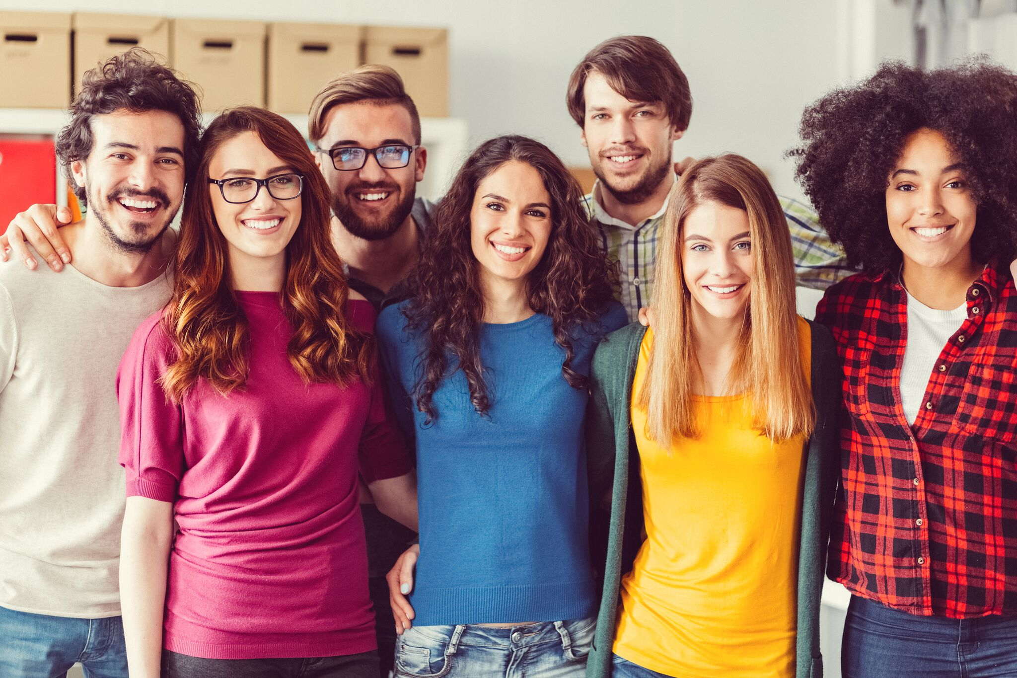 group of seven multi-ethnic students smiling