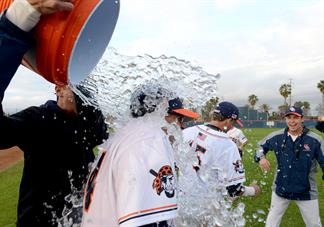 occ baseball team pouring ice water on coach john altobelli