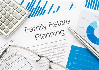 photograph of documents labeled estate planning with calculator pen and glasses