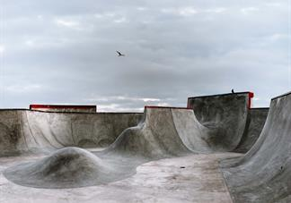 photography of empty skatepark concrete ramps