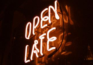 neon sign that says open late