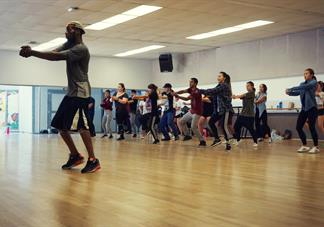 choreographer at mesa dance festival leading dancers in routine