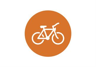 orange circle with white bicycle icon in middle