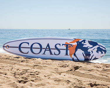 OCC surfboard on the sand at the beach