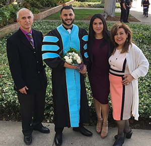 Kaveh and his family during his doctoral graduation ceremony at CSUF.