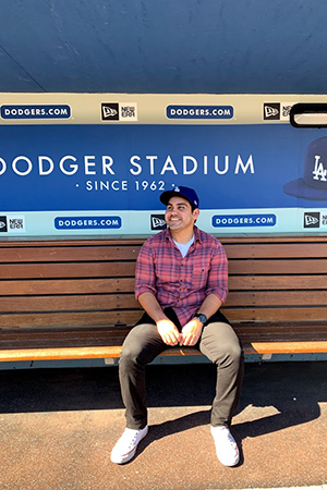 Greg at Dodger Stadium sitting in the Dodger dugout.