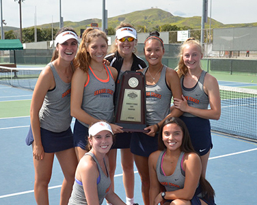 OCC Women's tennis team holding a championship troph